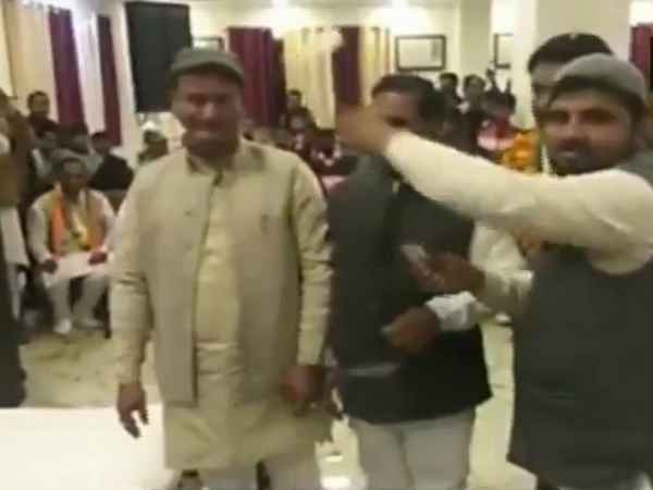 Congress party workers shower currency notes on Congress leader Virendra Rawat
