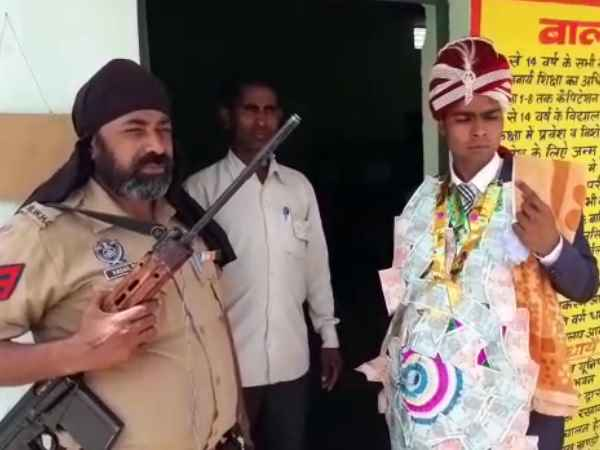 A groom casts his vote at a polling station in Bijnor