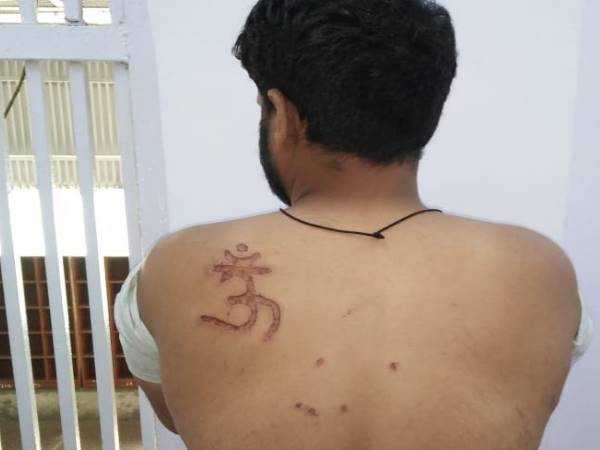 om tattoo on back of muslim prisoner in tihar jail, complained at Karkardooma court