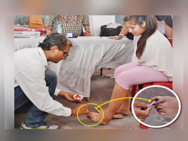 handicap girl without hands cast her vote, polling staff mark ink on foot
