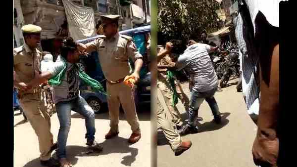 video, cruelty of daroga and constable beating a man