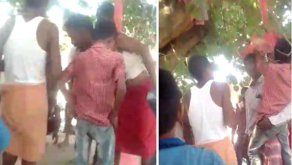 villagers tied two boys on the tree and beat him