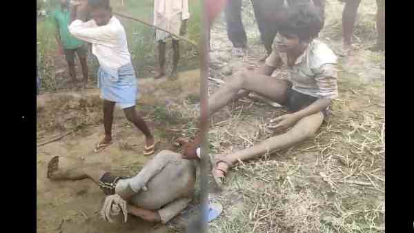 video, villagers cruelly beating a man for buffalo theft