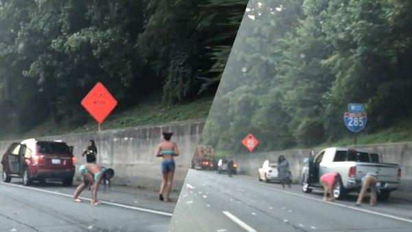 बीच सड़क गाड़ी खड़ी करके नोट उठाने लगे लोग