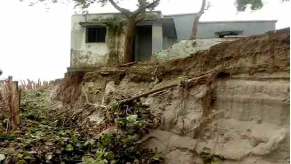 after heavy rain school wall fallen in the river ganga