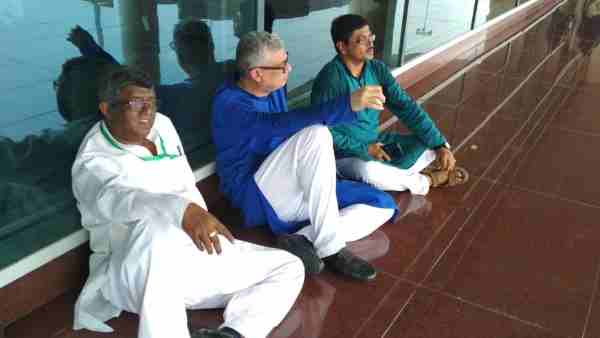 TMC delegation sit on a dharna at Varanasi airport after they were stopped by police