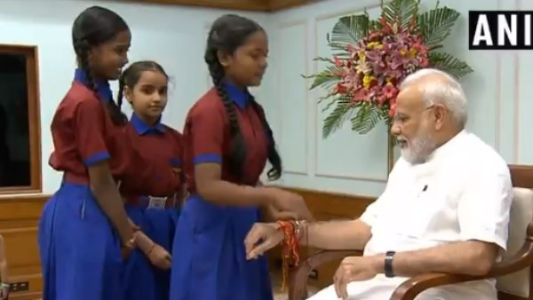 Raksha Bandhan 2019 Women and children tie rakhi to PM Narendra Modi in delhi