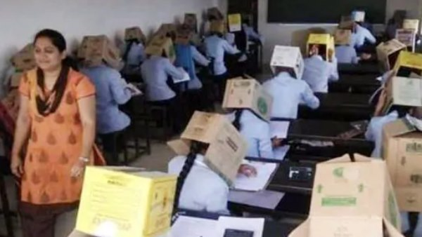 students at a private college in Karnataka wear cardboard boxes during an exam Stop Them from Cheating