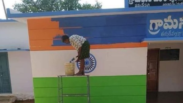 tricoloured building being repainted with colours resembling YSR Congress partys flag colour