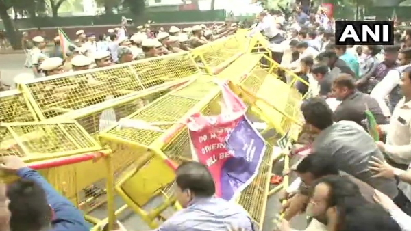 BJP workers angry over Rahul Gandhis remarks protests in front of Congress office