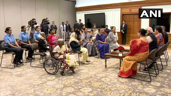 Prime Minister Narendra Modi talks to women honored with Nari Shakti Puraskar on Women Day