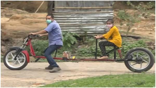 लॉकडाउन: महामारी से सुरक्षा के लिए त्रिपुरा के युवक ने बना डाला 'सोशल डिस्टेंसिंग बाइक'