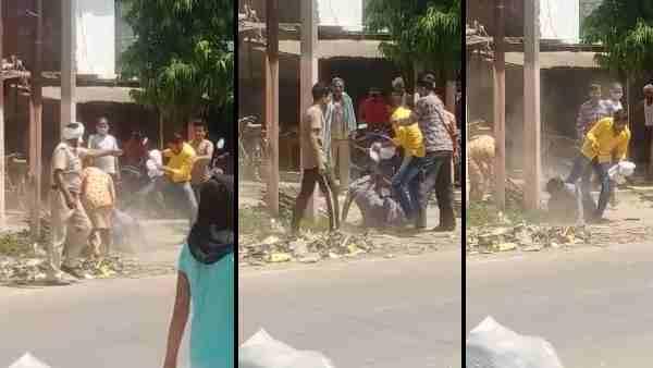 यूपी पुलिस के सामने महिला को लात-घूसों और डंडों से पीटा, VIDEO वायरल होने के बाद दो पुलिसकर्मी निलंबित