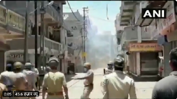 Watch Video: clash erupts between migrant workers and gujarat police in Surat during covid 19 lockdown