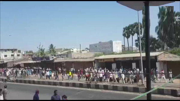 crowd of Migrant workers staged protest at Hazira industrial area in Surat, 55-60 were arrested by Police