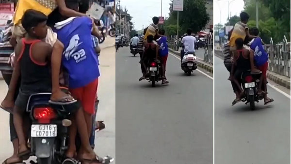 watch: a man drive motorcycle with five children in covid-19 lockdown at bharuch, video goes to viral