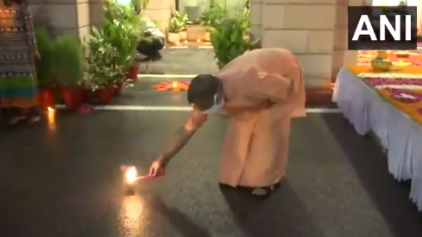 Yogi Adityanath lights a firecracker at his official residence in Lucknow as part of deepotsav