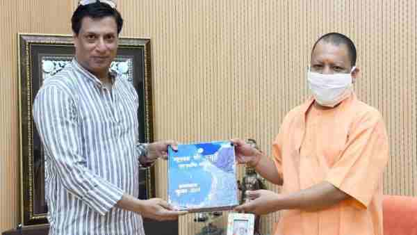 Lucknow: Filmmaker Madhur Bhandarkar arrives to meet Chief Minister Yogi Adityanath at the latters office