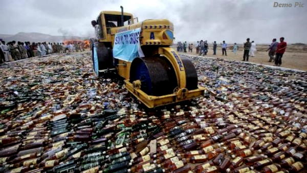 66088 Illegal liquor bottles destroyed by Bulldozer in anand gujarat