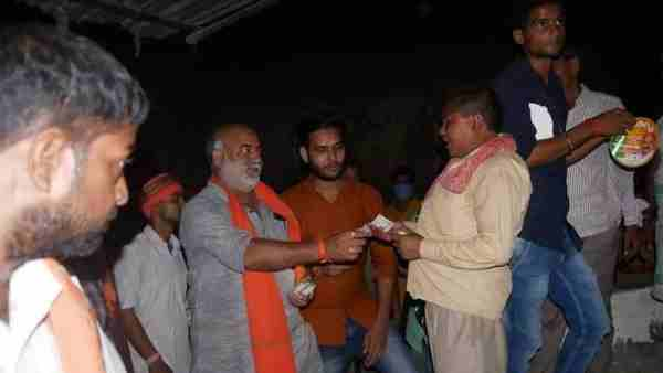 UP by-election: BJP candidate from Malhani seat Manoj Singh distributed money among voters