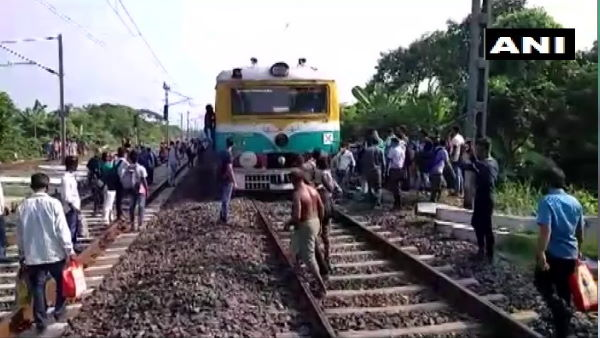 West Bengal: People blocked railway tracks at Chuchura station demanding train services for everyone