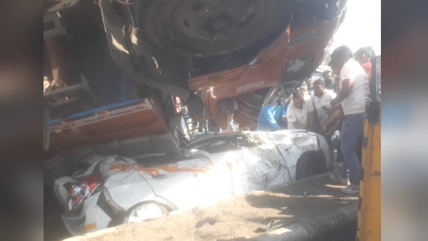 in Gujarat, 10-wheeler truck overturns on car, but driver Miraculously escape