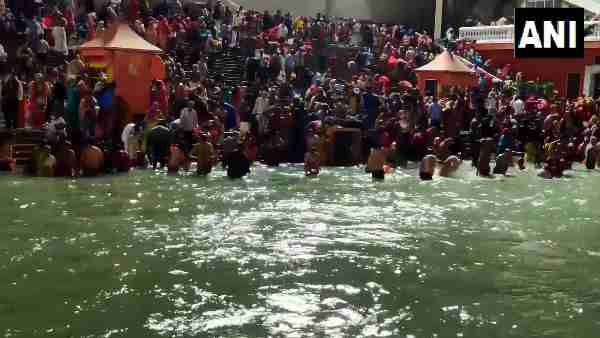magh purnima 2021: people take holy dip on the occasion