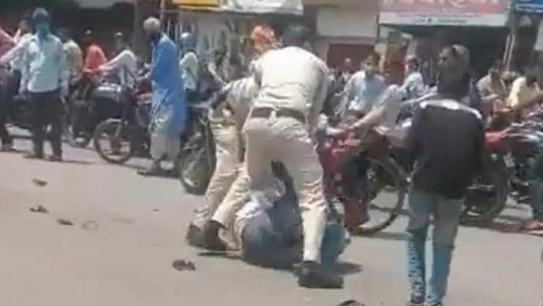 indore two policemen suspended for assault of man not wearing face mask