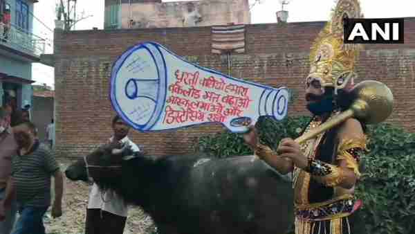 Moradabad: A local artist, dressed as Yamraj, creats awareness among people about COVID19 pandemic