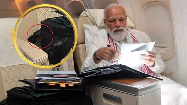 पीएम मोदी ने शेयर की फ्लाइट-मोड 'वर्क' की फोटो, सूटकेस पर टगे ताले को देख लोग बनाने लगे मजेदार मीम