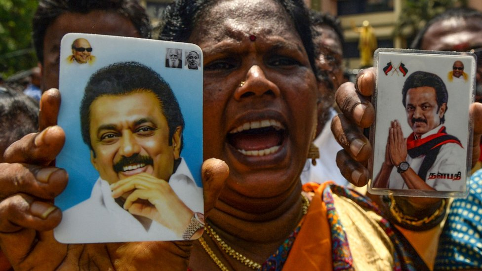 A supporter with a picture of DMK chief MK Stalin
